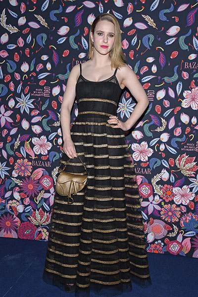 Rachel Brosnahan wore a Dior Pre-Fall 2020 black and gold striped tulle dress with a Dior gold mini Saddle bag and Dior shoes. Photo by Pascal Le Segretain/Getty Images)